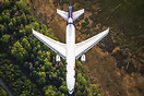 A FedEx MD11 coming in for a landing in Anchorage as seen from a helic...