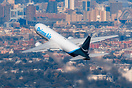 An Air to Air Shot of an Amazon Prime Air Boeing 767 departing JFK ove...