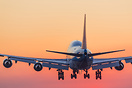 KLM boeing 747 coming in to land at dawn
