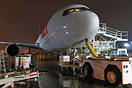 Unloading cargo operations at night in Fedex Cargo ramp