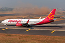 As Spicejet's B738 holds short of R27, in the backdrop, a technically ...