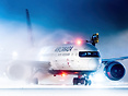 De-icing in the snow before a cargo departure to Mexico City