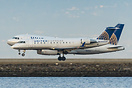 An Airbus A319 and Crj-200 land side by side at San Fransisco just aft...