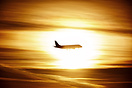 KLM Embraer crossing the sun