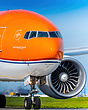 Close-up of Orange Pride taxiing out for an afternoon departure to Ams...