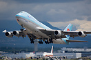 Heavily loaded Dash 400 freighter from Korean Air is taking off using ...