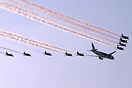 A BMI A320 and the Red Arrows perform a flypast at the 2007 Jersey Int...