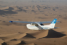 210L Centurion II V5-JCC in flight over the Namib Desert