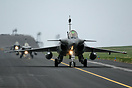 A line of 3 Rafales head to the runway for a mission during exercise J...