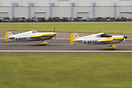 The pair of racers taking off to give a 'demo' at Duxford Airshow
