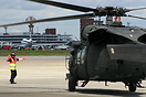 UH-60 Blackhawk helicopter being Marshaled on to an awaiting parking s...