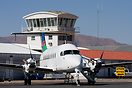 Air Namibia Beech 1900 in front of the Eros airport ATC Tower