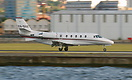 This Citation 560XL touches down, the pilot deploy the reverse thruste...
