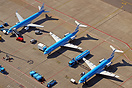 KLM's Fokker aircraft seen with the new Embraer 190 in the background....