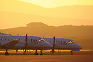 Two Loganair Saab 340s rest in the evening sunshine after completing t...