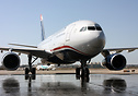 Inaugural US Airways service from PHL taxies across a wet ramp followi...
