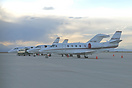 Sunset at Centennial with a variety of corporate jets awaiting their c...