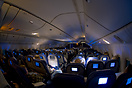 Economy class in the middle of the night somewhere between Dubai and A...