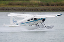 A DHC-2 Beaver taking off from a river near the Vancouver sea terminal