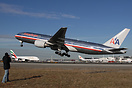 An American 777  seen here departing to Tokyo showing off its size and...