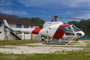 An AS350 at the Bora Bora Heliport in Vaitape waiting to operate the n...